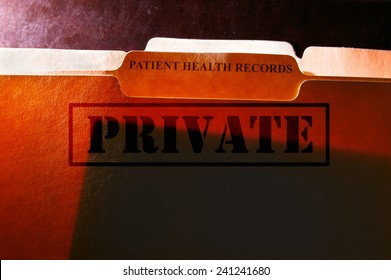 File folders with Patient Health Records label and Private stamp
