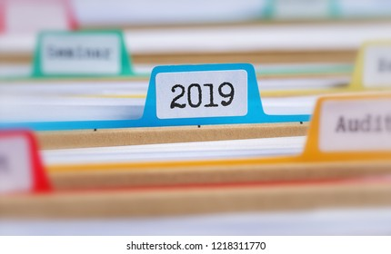 File folders with a tab labeled 2019