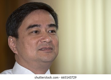 File photo of Former Thai Prime Minister Abhisit Vejjajiva answers the question from media at Parliament in Bangkok on April 24, 2014
