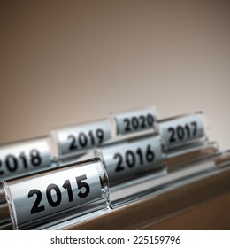 File tab with focus on 2015 year, beige background. Image concept for illustration of mid-term or long-term business strategy.