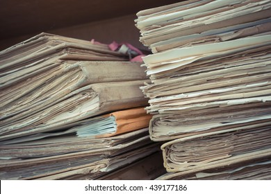 Files in old folder stacking up in a messy order. , process in vintage style