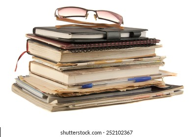 Files stacking up in a messy order isolated on white background.