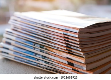 Files stacking messy student homework books on teacher desk in school. Old magazines or documents reports on office
