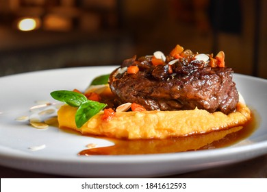 Filet mignon garnished with sweet potatoes
