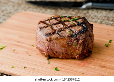 Filet mignon. Grade A grass fed angus beef steak. Tenderloin, filet mignon, New York strip, bone in rib-eye grilled medium rare on outdoor grill. Classic American steakhouse entree favorite.