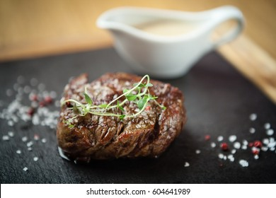 Filet mignon served on a stone board in restaurant