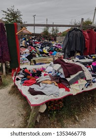 Filiasi, Romania, 30-09-2018: old clothes and second hand objets for selling in Filiasi market on the street