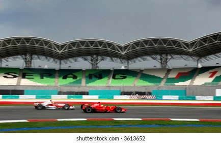 Filipe Massa & Ralf Schumacher in action during F1 practice session in Sepang Malaysia