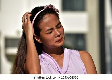 Filipina Adult Female And Sadness