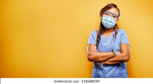 filipina nurse wearing facemask and PPE on orange background