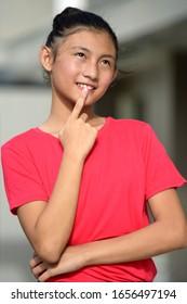 Filipina Teen Girl Making A Decision