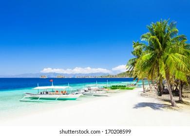 Filipino boat in the sea near the beauty beach at Boracay island, Philippines