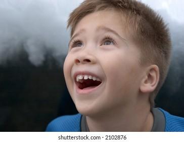 Filipino Boy Staring in Wonder at Falling Water - Focus on Near Eye