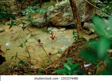 Filipino children swimming in the river on Nov 27, 2018 in Mindoro, Philippines.