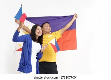 filipino couple holding flag celebrating independence day of philippines