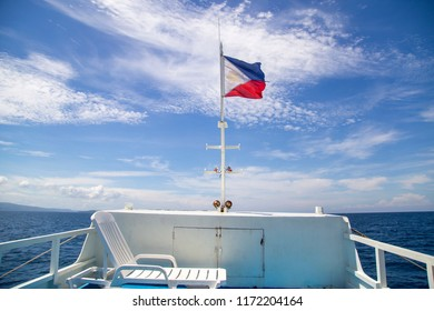 Filipino flag flying in a ferry boat from Davao to Samal island, Mindanao province, Philippines.