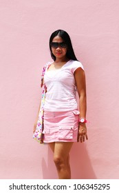 Filipino girl wearing pink, posing for a photo, Thailand.