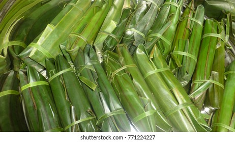 Filipino Homemade steamed rice (suman) wrapped in banana leaves