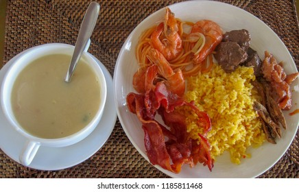 Filipino Lunch with boiled shrimp, bacon, rice and coffee