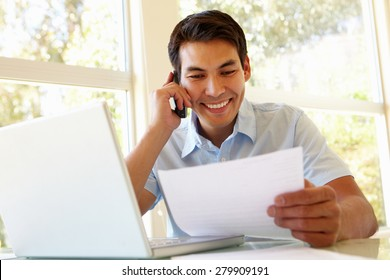 Filipino man working at home