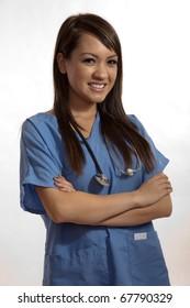 Filipino nurse doctor working on laptop computer