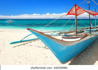 Filipino outrigger sail boat stranded on the beach, Boracay Island, Philippines
