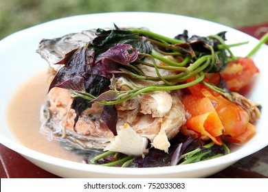 Filipino snapper fish head sinigang soup- with tomato and tamarind for sour taste.