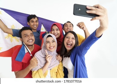 filipino supporter taking selfie self portrait together holding philippines flag during independence day