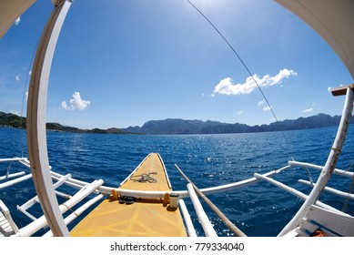 "Filipino traditional boat, idyllic ""vacations"" seascape with beautiful weather, blue sky and clear water."