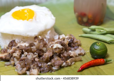 Filipino traditional dish: philippine pork sisig with rice and egg