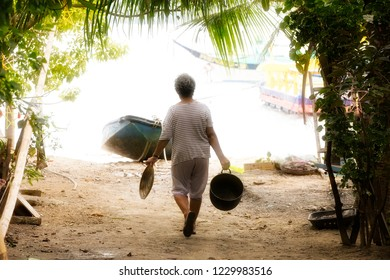 Filippino Housewife Carrying Out her Work Near Puerto Galera on Mindoro, Philippines