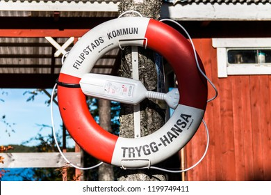 Filipstad/ Värmland/ Sweden,october 07-2018Lifebuoy hangs well visible on a Swedish lake for safety