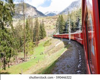 "Filisur, Switzerland: trains of the Rhaetian Railway in transit along the line ""St.Moritz - Chur""."