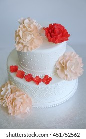 fill frame of birthday cake or wedding cake decorated by edible rose bloom on silver stand with white background