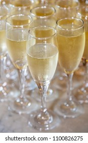 Filled champagne glasses ready for a celebratory toast