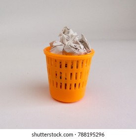 Filled garbage Basket on white background