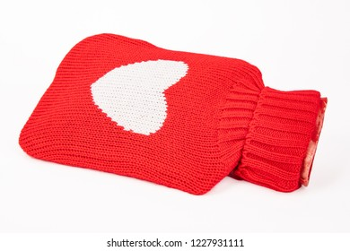 Filled Hot Water Bottle with red heart on white background