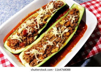 Filled zucchini with minced meat, cheese above