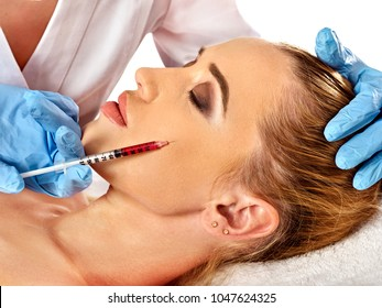 Filler injection for female face. Plastic aesthetic facial surgery and in clinic. Beauty woman giving injections in cosmetology room.
