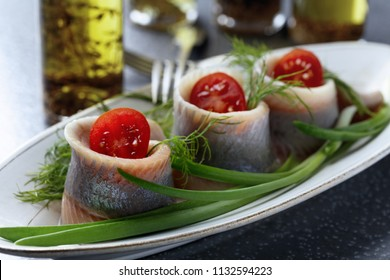 Fillet of Atlantic Herring in oil. Rolls with dill , green onion and cherry tomatoes .