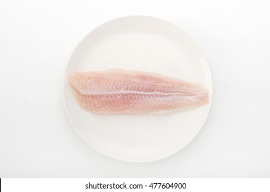 Fillet of Fish Pangasius. Isolated on white background.