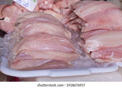 Fillet of fresh Guiaivira fish on ice.