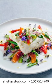 Fillet of hake with shaved asparagus and blood orange salad