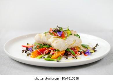 Fillet of hake with shaved asparagus and blood orange salad