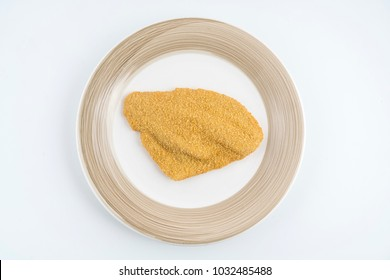 a fillet of plaice breaded frozen on the plate