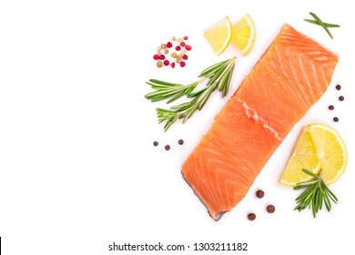 fillet of red fish salmon with lemon and rosemary isolated on white background with copy space for your text. Top view. Flat lay