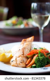 Fillet of salmon baked with our maple glaze, served on a bed of aromatic basmati rice with stir fry vegetables. Pairs perfectly with white wine.