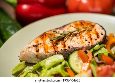 Fillet of salmon with cooked vegetables.
