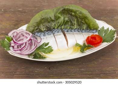 fillet, salted mackerel sliced and served on celedonia