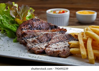 fillet steak with fries and beer